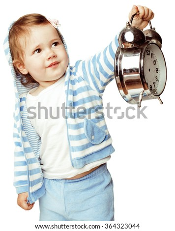 little cute girl in hood with clock alarm holding isolated on white background close up - stock photo