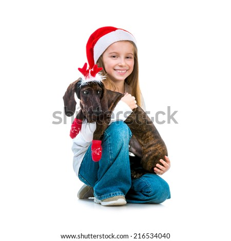 little cute girl in Santa Claus hat with a dachshund in a Christmas costume on white background isolated - stock photo