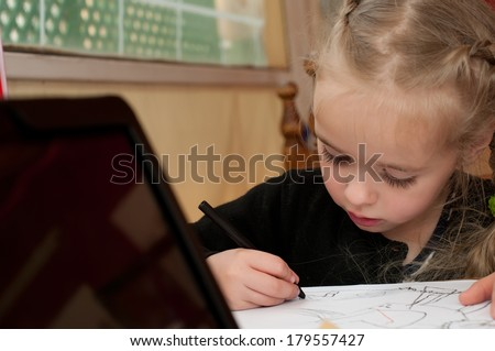 Little cute girl is drawing
