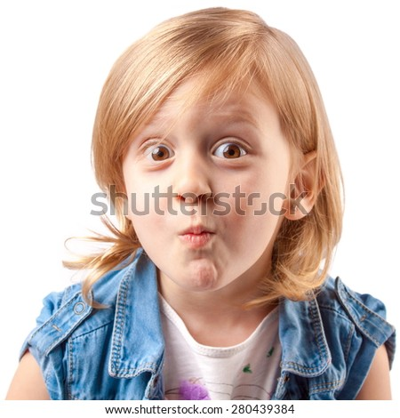 Little cute girl making grimace and having fun - stock photo