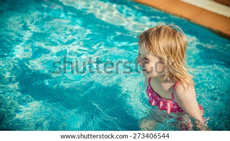 little cute girl near the pool - stock photo