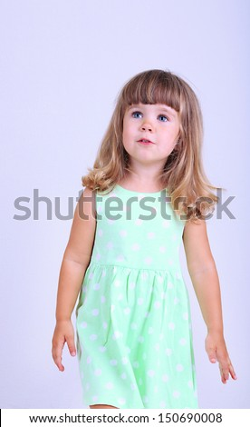 Little cute girl, on gray background