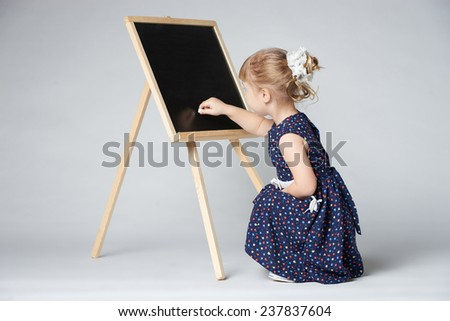 little cute girl painting - stock photo