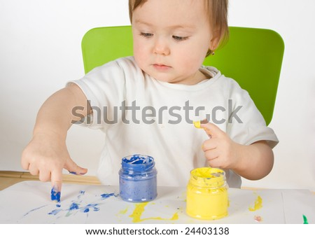 little cute girl painting with own hands - stock photo