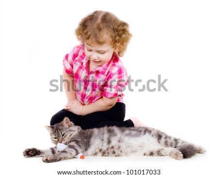 little cute girl plays doctor with cat on white background