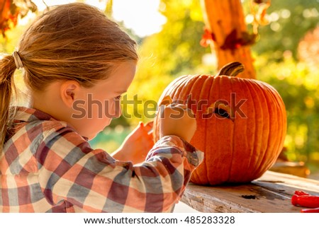 little cute girl preparing for hallowe'en