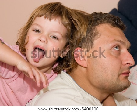 little, cute girl spending time with her father