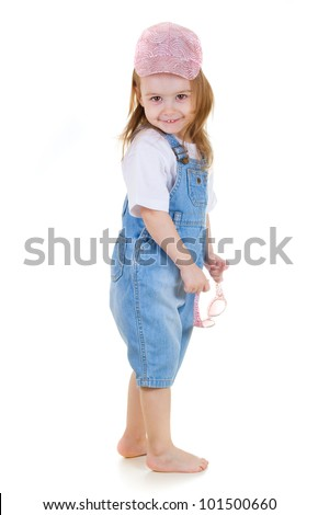 Little cute girl stays holding in sunglasses in her hands  on white background - stock photo