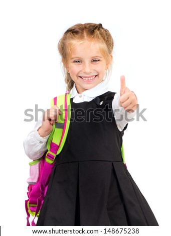 little cute girl with a backpack with thumbs up - stock photo