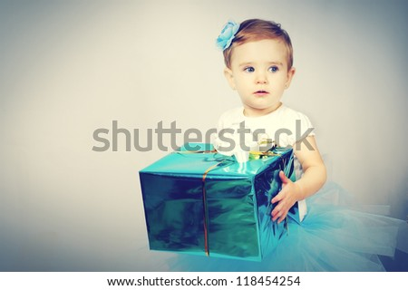 Little cute girl with a gift - stock photo