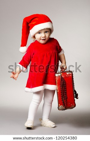 little cute girl with christmas suitcase - stock photo