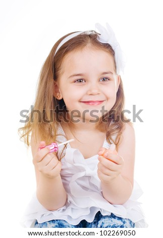 little cute girl with lipstick on white background - stock photo