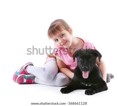 Little cute girl with puppy isolated on white - stock photo
