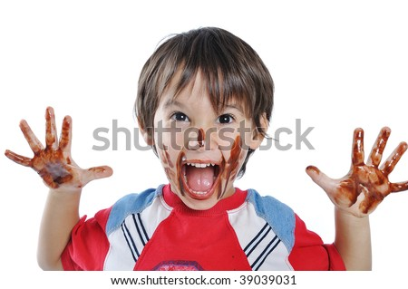 Little cute kid with chocolate on face and hands
