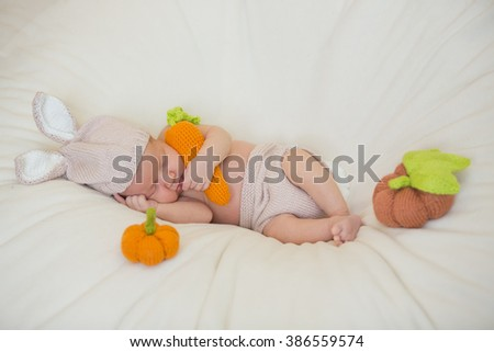 little cute newborn baby dressed like easter bunny