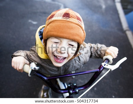 little cute real boy on bicycle smiling close up emotional posing autumn street, lifestyle people concept