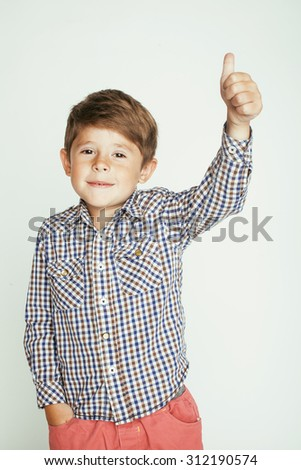 little cute real boy on white background gesture smiling close up - stock photo
