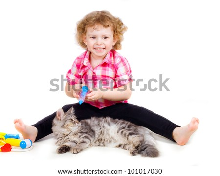 little cute smiling girl plays doctor with cat on white background
