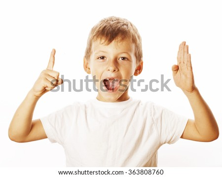 little cute white boy pointing in studio isolated close up - stock photo