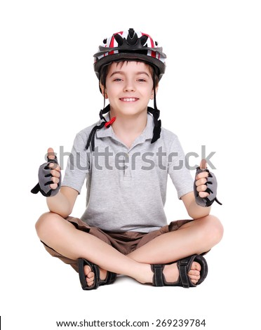 little cycling sitting on the floor showing thumbs up - stock photo