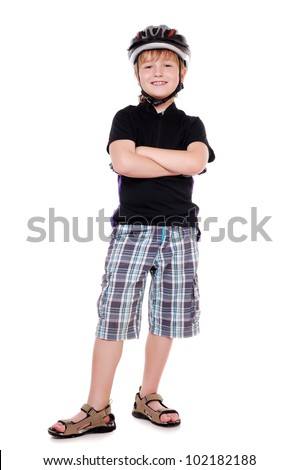 Little cyclist  full length portrait with crossed hands in a white studio