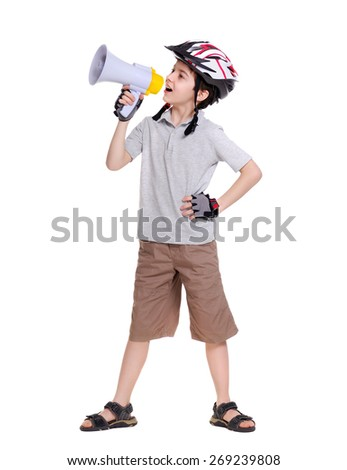 Little cyclist  shouting loud into the megaphone full length portrait - stock photo