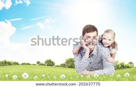 Little daughter hugging her father. Parenting concept