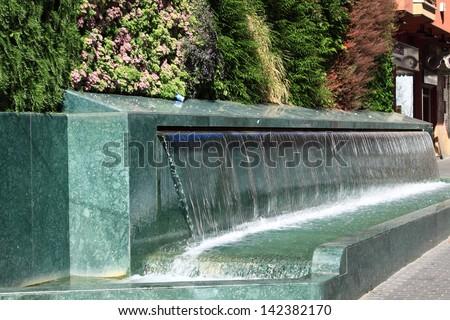 Little decorative waterfall - stock photo