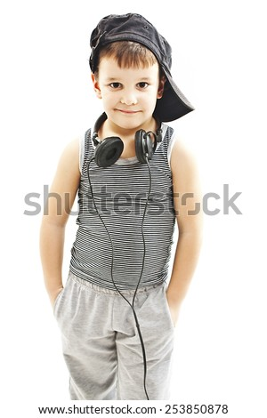 Little deejay. funny smiling boy with headphones.  Isolated on white background - stock photo