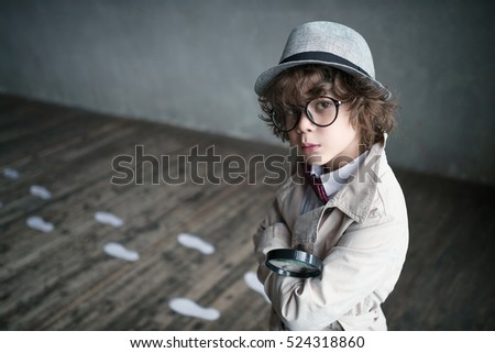 Little detective in studio