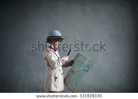 Little detective with a map
