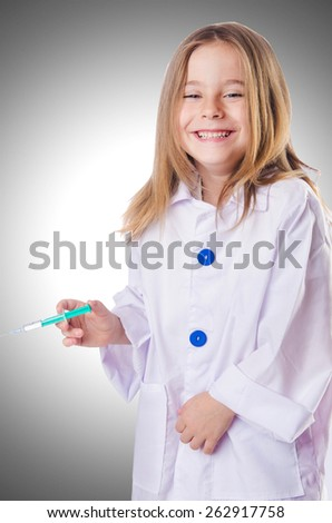 Little doctor with syringe - stock photo