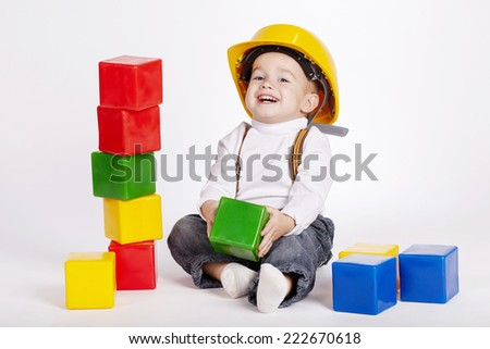 little engineer plays with cubes - stock photo