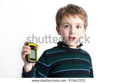Little explorer - A studio shot of a 6 years old boy with a GPS in his hand - stock photo