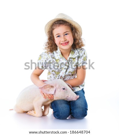 Little farmer. Cute girl with pig. Isolated on white background.