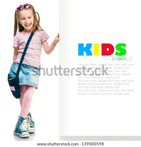 little fashion girl  behind a white board - stock photo