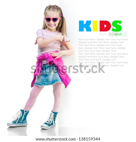 little fashion girl  behind a white board isolated background