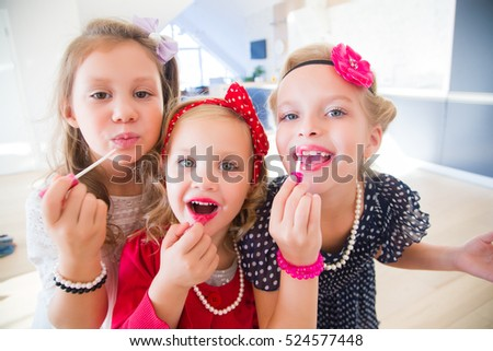 little fashion-girls lipstick front of the mirror