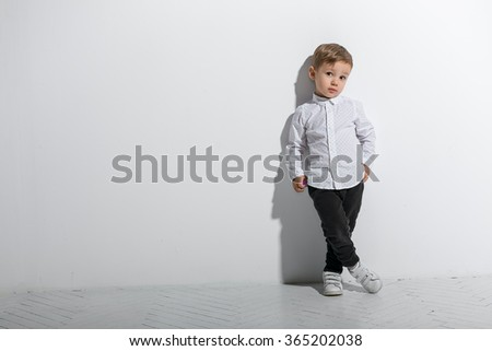 Little fashionable boy. Isolated on white background - stock photo