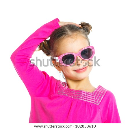 Little fashionable girl in the glasses. Isolated on white background