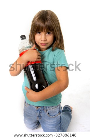 little female child holding big cola soda bottle looking vulnerable in children sugar addiction and bad habit nutrition concept isolated on white background - stock photo