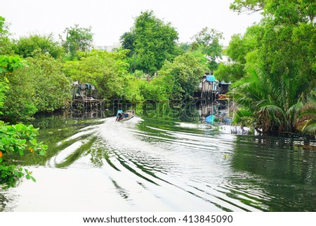 Little fishing boat  in the canal with green forest background:Close up,select focus with shallow depth of field. - stock photo