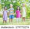 Little Friends Holding Hands in The Park - stock photo