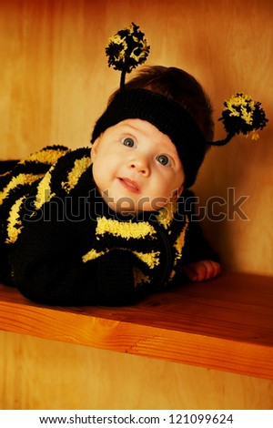 little funny baby with bee costume - stock photo