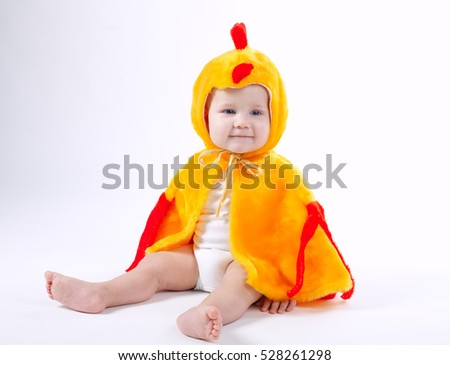 little funny boy in chicken costume