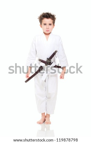 Little funny boy in kimono with swords isolated on white - stock photo