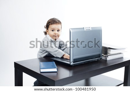 little funny boy with laptop - stock photo