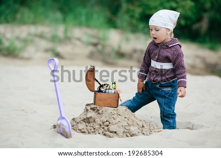little funny girl hunting for treasure - stock photo