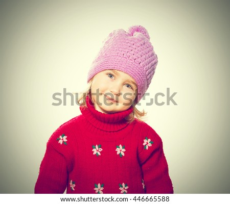 Little Funny girl in cap and red sweater. Isolated on white background - stock photo
