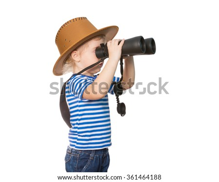 Little Funny girl in striped shirt and hat looking through binoculars. Isolated on white background - stock photo